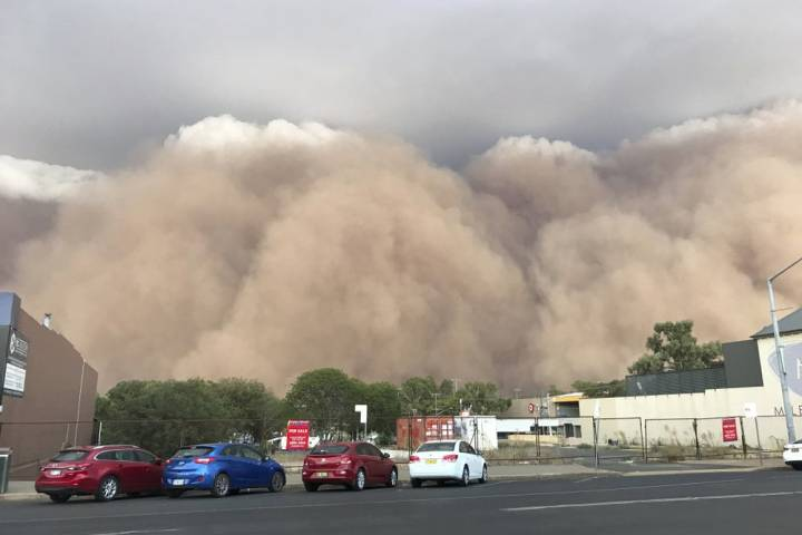 Photo of Australia hit with flash flooding, dust storms as wildfires rage