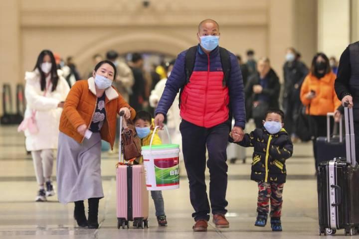 Photo of China urges residents to avoid public gatherings as coronavirus cases spike