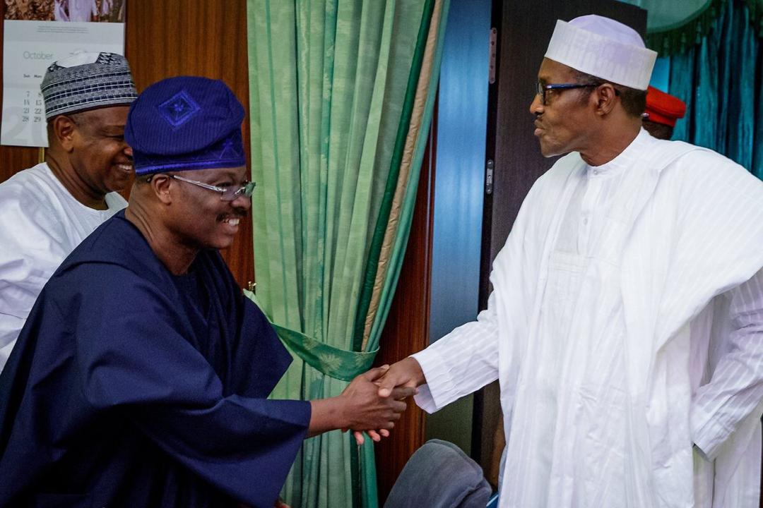 Photo of Buhari felicitates with ex-Gov. Ajimobi at 70