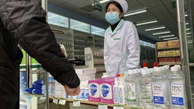 Photo of New virus cases in China drop as authorities modify detection method again