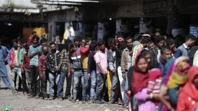 Photo of Coronavirus: Indian migrant workers defying COVID-19 curfew, crowd trains