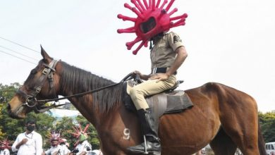 Photo of 'Corona cops' wearing spiky 'virus' helmets during India's lockdown