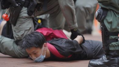 Photo of Police fire water cannon, tear gas at Hong Kong protesters
