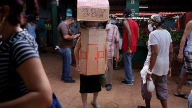Photo of Cuban woman, 82, wears full-body cardboard shield to guard against coronavirus